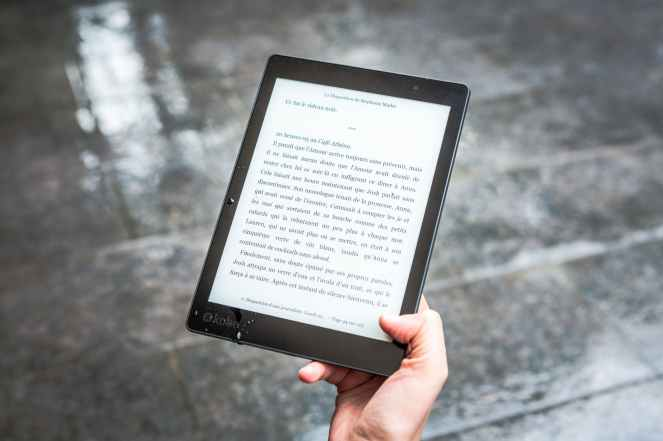 person holding black e book reader